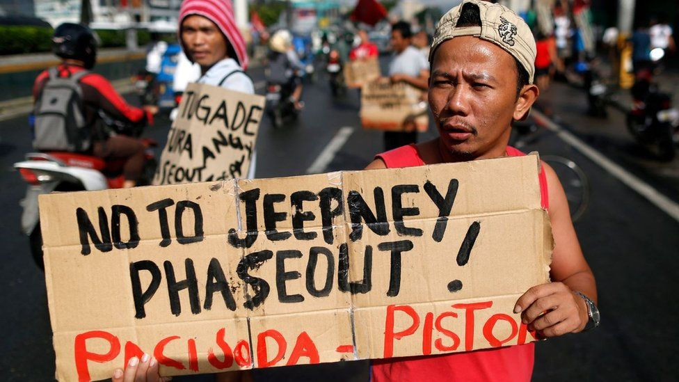 A Filipino driver at a protest to oppose government plans to phase out old and dilapidated jeepneys