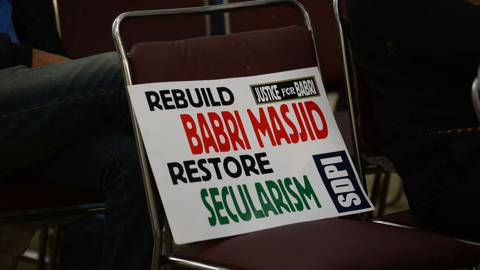 A placard is seen on a chair during a protest by Indian activists to mark the 24th anniversary of the destruction of the Babri Mosque in New Delhi on December 6,2016.