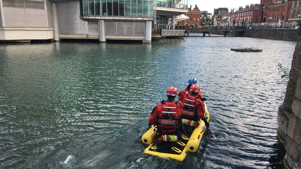 Humberside Fire and Rescue Service crew in an inflatable raft on water