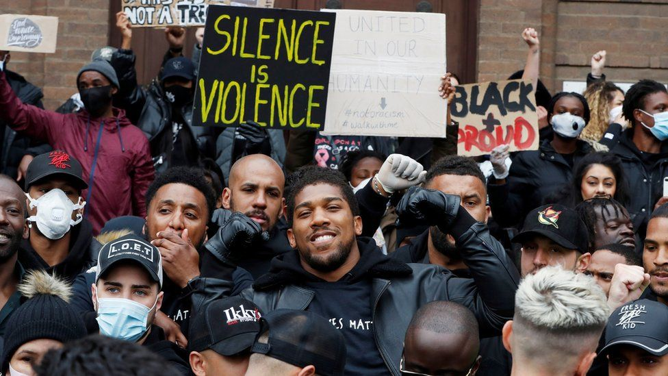Boxer Anthony Joshua joined protesters in Watford