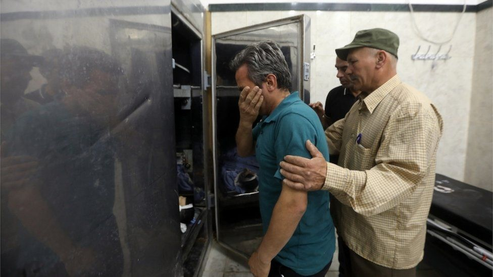 Relatives of the killed Palestinian security officers weep in the morgue