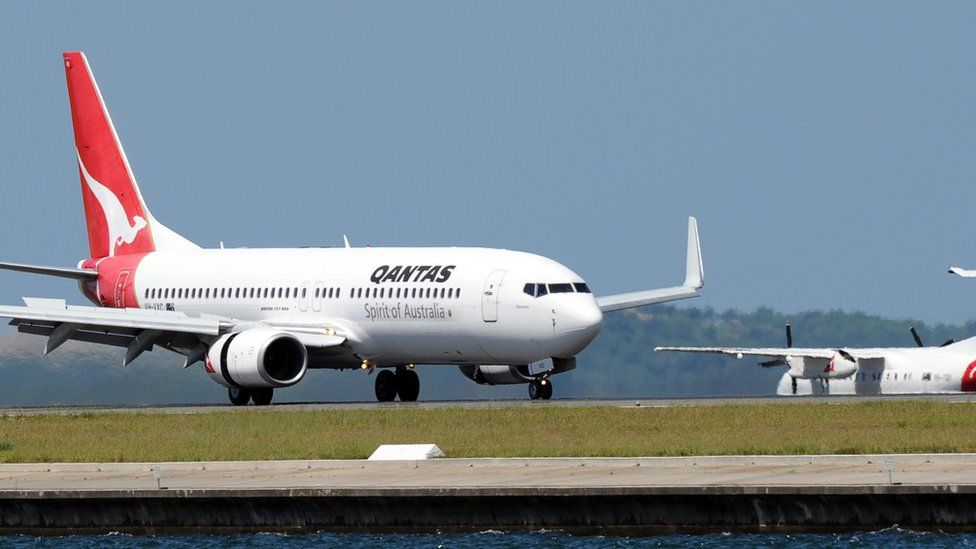 A Qantas Boeing 737 plane prepares for take off at Sydney Airport