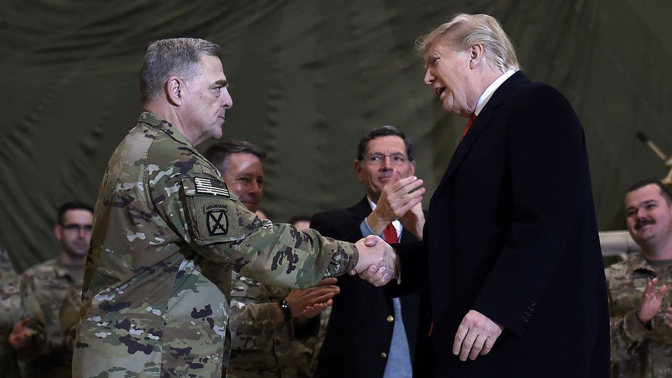 President Trump shaking hands with Joint Chiefs Chairman General Mark Milley at Bagram Air Field in Afghanistan on Thanksgiving