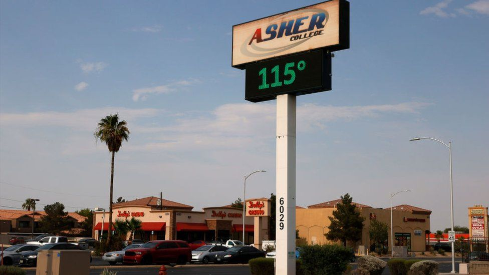 A digital sign displays a temperature of 115 degrees Fahrenheit in Las Vegas
