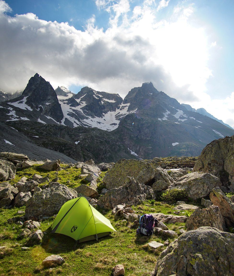 A tent camped amongst the mountains