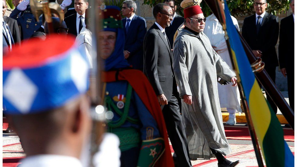 Rwanda's President Paul Kagame, 2nd right and Morocco's King Mohammed VI, right, arrive to a ceremony at the Royal Palace in Casablanca, Morocco, Monday 20 June 2016.