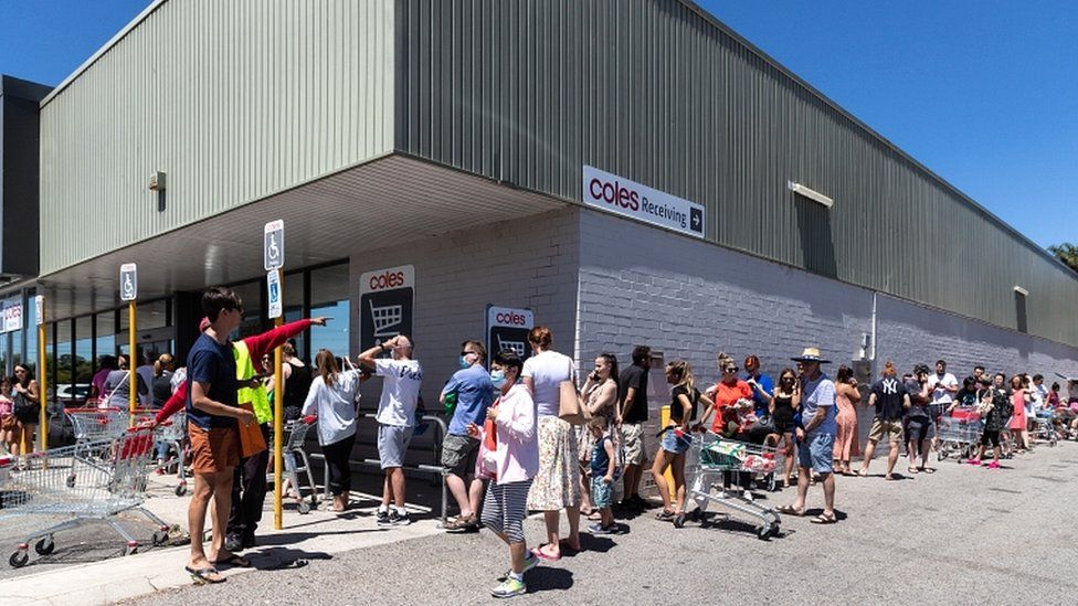 People queue outside a supermarket in Perth, Australia, on 31 January 2021