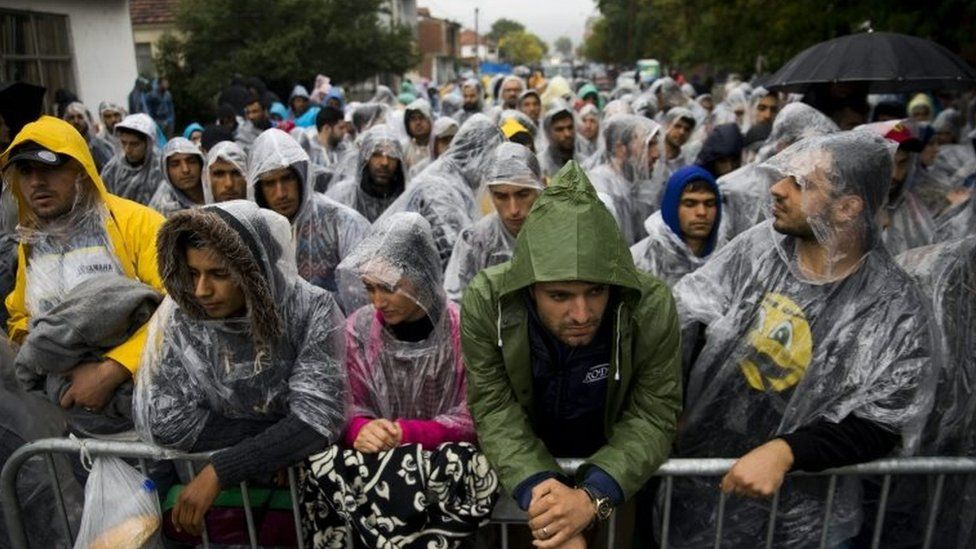 Migrants wait to be registered at the registration camp in Presevo, Southern Serbia (07 October 2015)