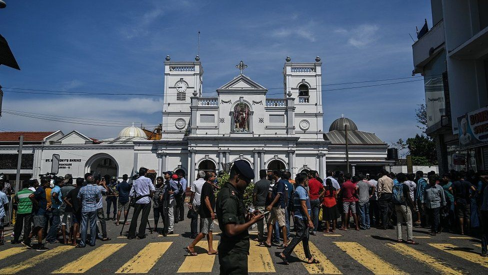 "Local residents gather outside the St. Anthony""s Shrine in Colombo on April 22, 2019, a day after the building was hit as part of a series of bomb blasts targeting churches and luxury hotels in Sri Lanka."