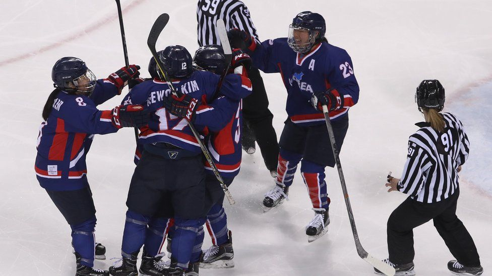 Randi Heesoo Griffin and her teammates celebrate scoring a goal against Japan.