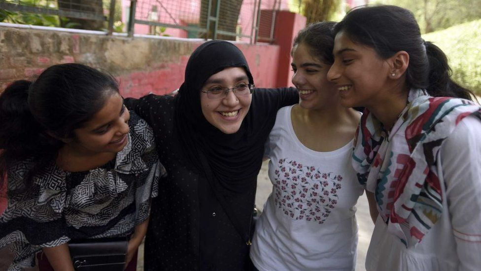 A Muslim mother with her daughter and her friends celebrates at St. Thomas School after the class 10th CBSE result announced, on June 3, 2016 in New Delhi, India.