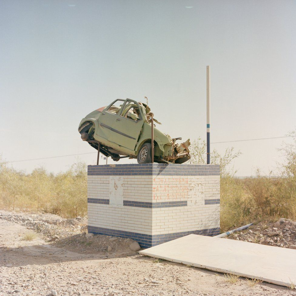 A car on a plinth to warn drivers