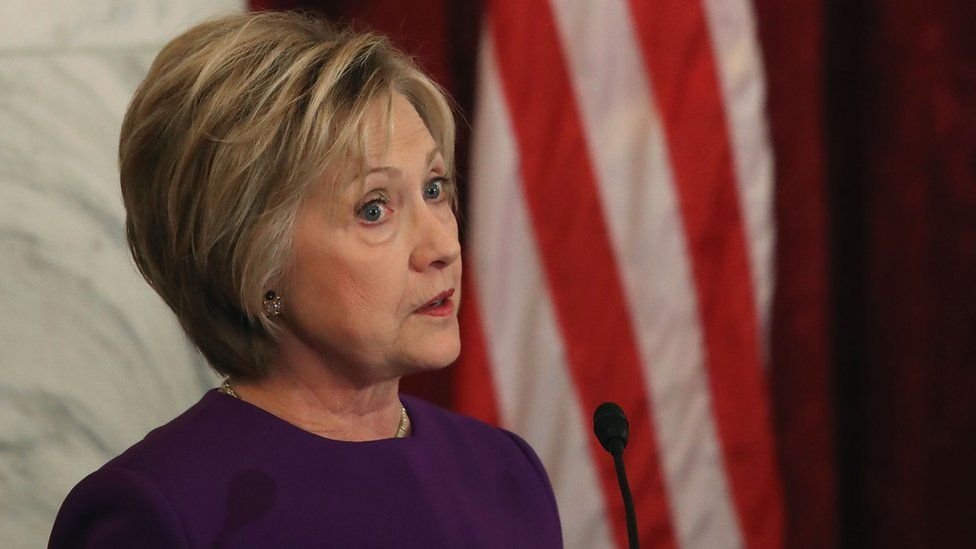 A picture of Hillary Clinton. She says false stories hurt her presidential campaign