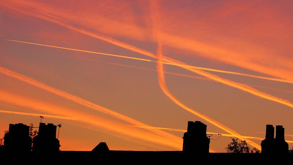 Vapour trails from aircraft landing and taking off from Heathrow and London City airports