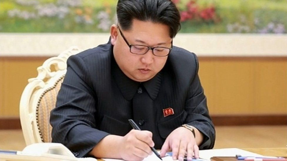 This picture taken from North Korean TV and released by South Korean news agency Yonhap on January 6, 2016 shows North Korean leader Kim Jong-Un signing a document of a hydrogen bomb test in Pyongyang.