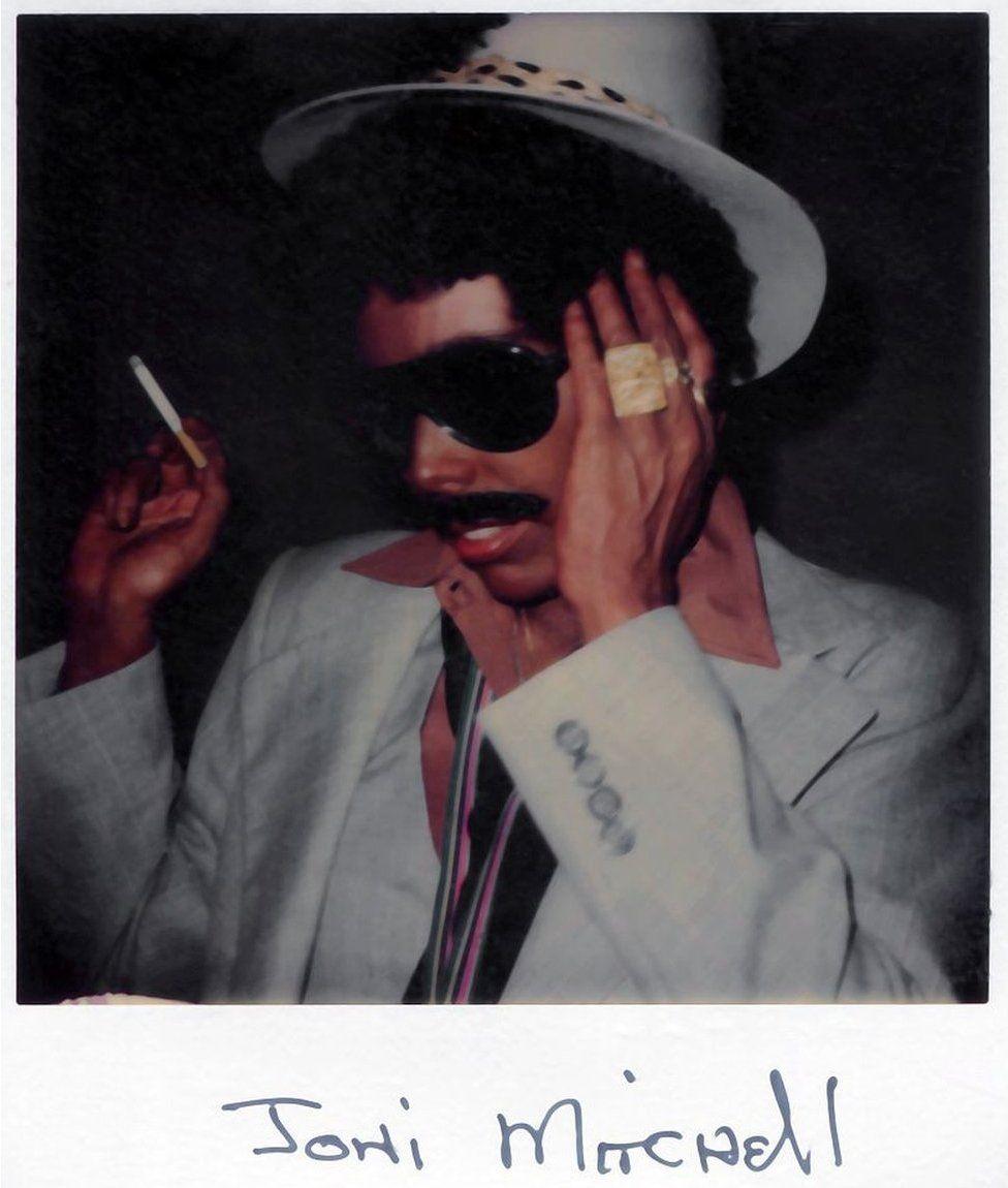 Polaroid of Joni Mitchell in blackface
