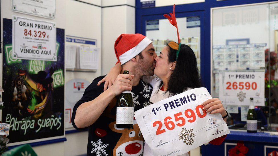Pablo Nogales and his wife Paloma Rodriguez celebrate selling the winning ticket of the biggest prize at a lottery administration in Sevilla on 22 December 2019.