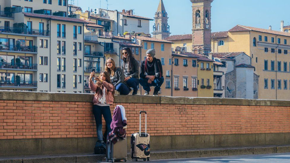 Group of young people taking a photo of themselves in Florence