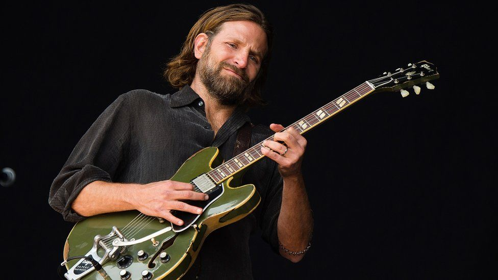 Bradley Cooper performs at the UK's Glastonbury music festival