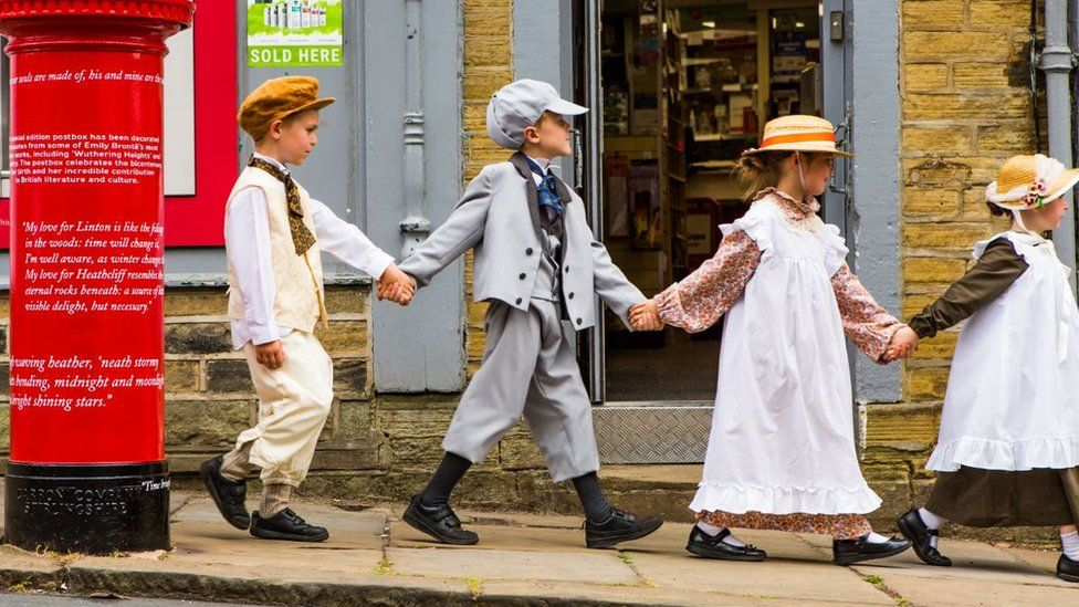Year Four children from Thornton Primary School dressed in 19th century clothes to post letters into the commemorative postbox
