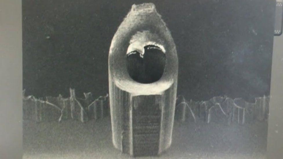 A micro needle pictured under a microscope