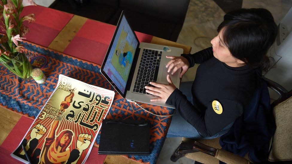 Designer Lubaina Rajbhoy creates a poster for a women's march