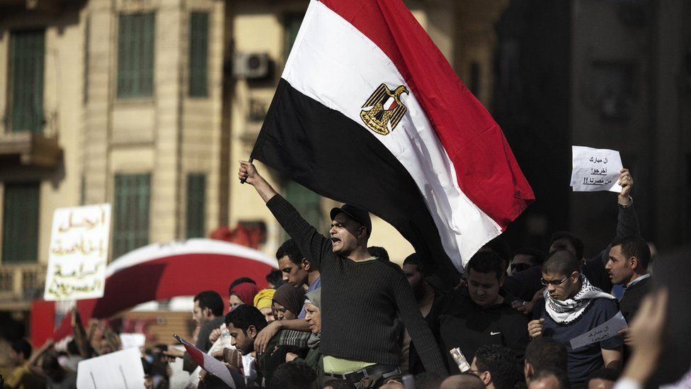 Egyptian demonstrators wave their national flag in Tahrir Square in central Cairo on January 30, 2011