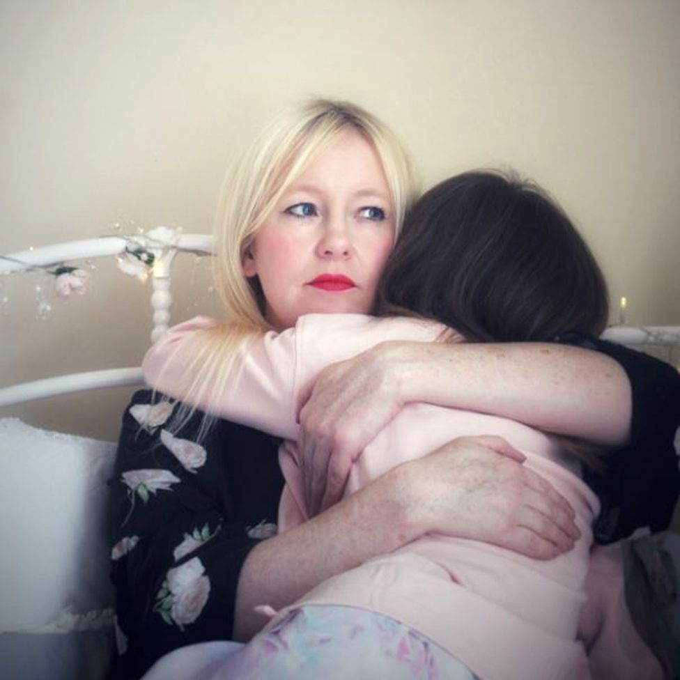 Tracy holds her daughter