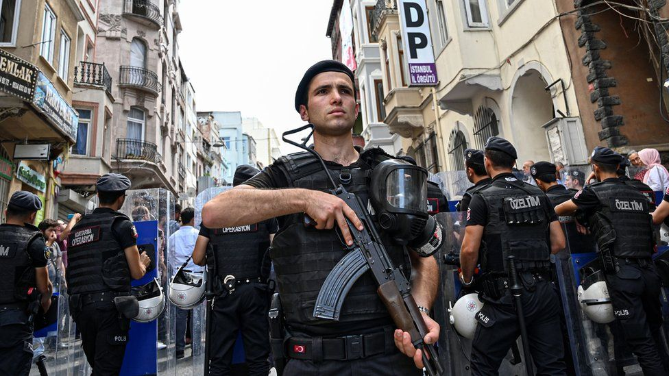 Turkish anti-riot police officers guard the headquarters of the pro-Kurdish Peoples' Democratic Party (HDP) in Istanbul, 19 August 2019