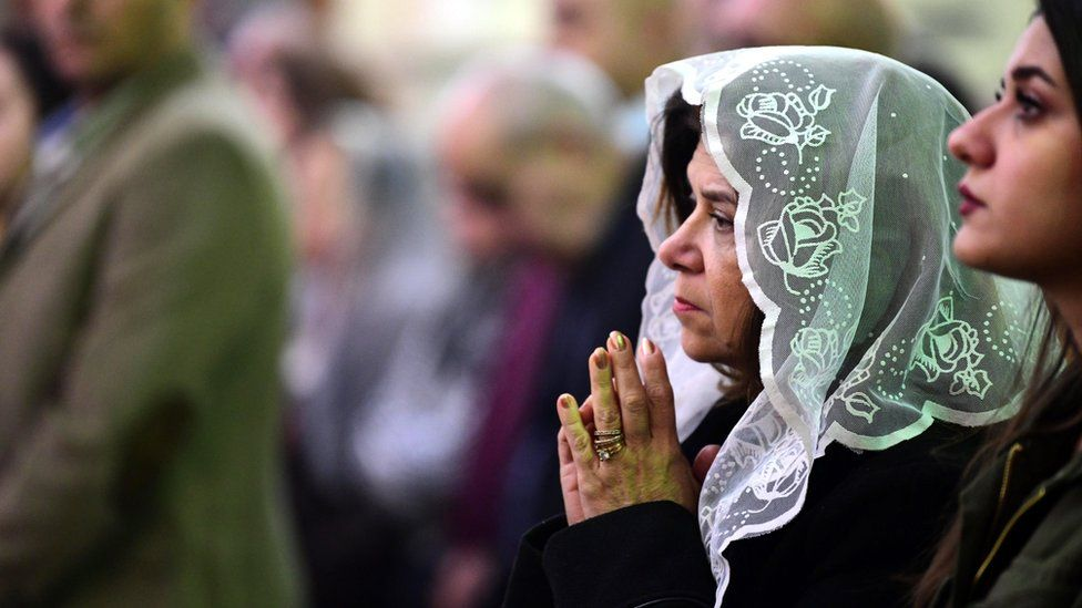 Iraqi Christians attend a Christmas Mass at St. George Anglican church in Baghdad