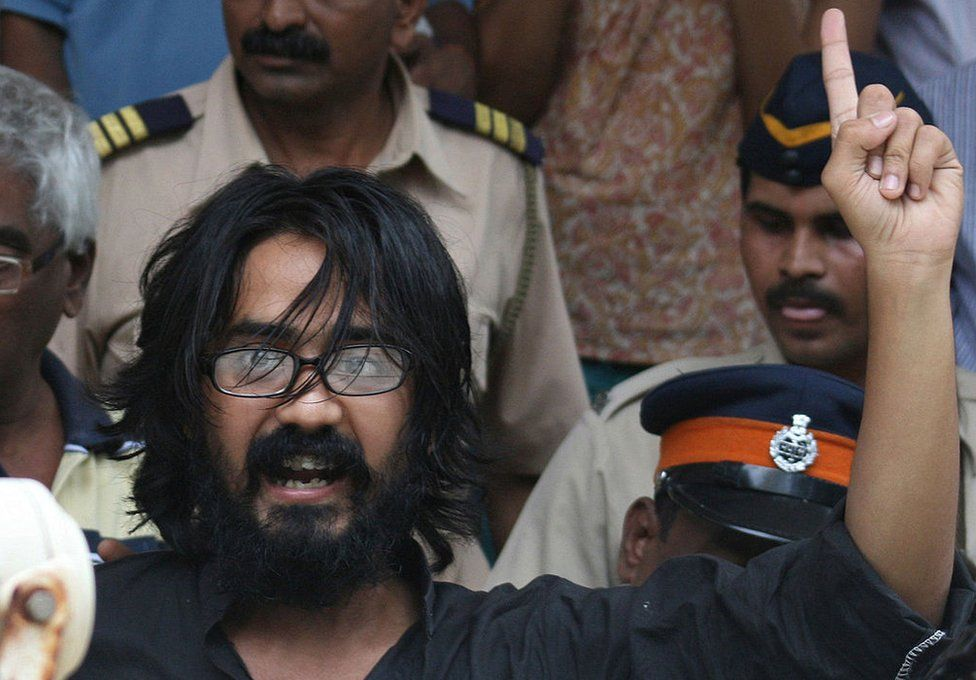 In this photograph taken on September 9, 2012, Indian cartoonist Aseem Trivedi gestures outside a court in Mumbai .