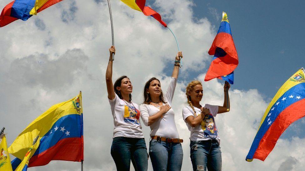 Patricia de Ceballos (L), wife of the imprisoned former mayor, Daniel Ceballos, Venezuelan opposition ex-congresswoman Maria Corina Machado (C) and Lilian Tintori , wife of jailed opposition leader Leopoldo Lopez