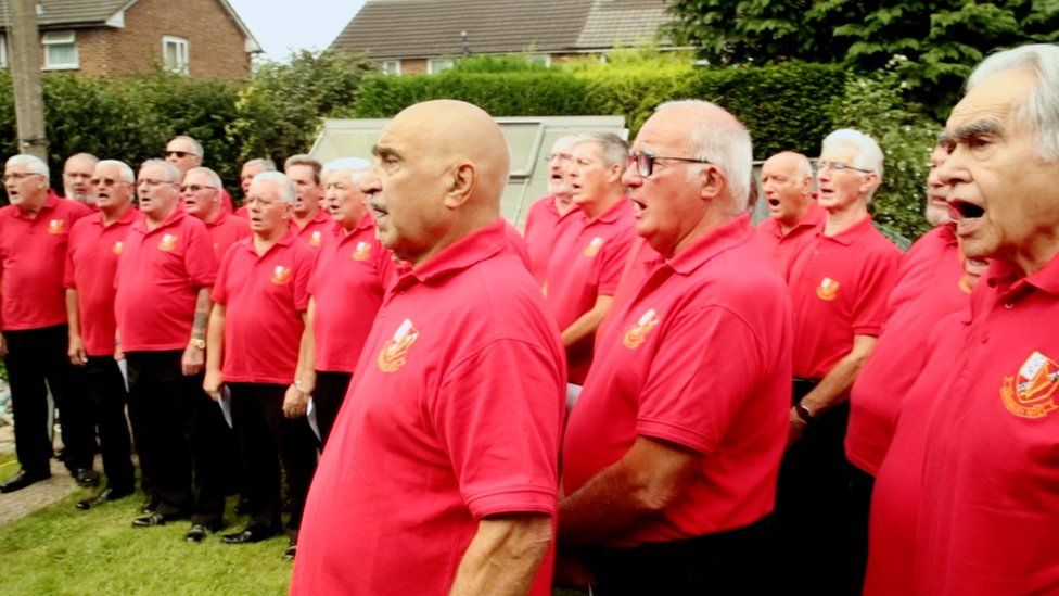 More than 20 members of Aber Valley Male Voice Choir snuck into Emlyn's garden