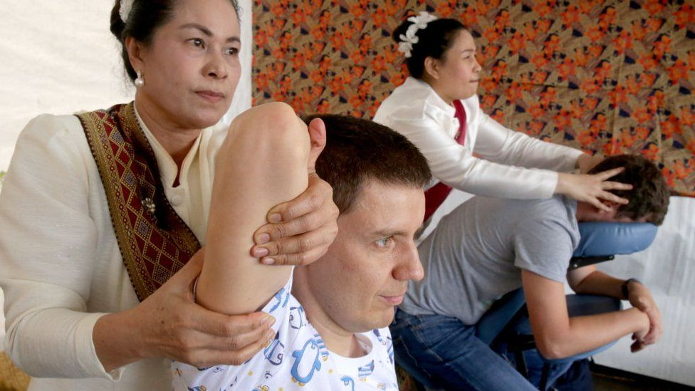 Visitors receive traditional Thai massage at the 6th Thai culture festival held by the Royal Thai Embassy in Moscow