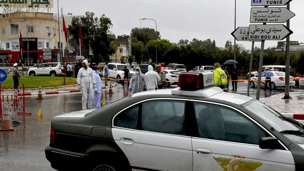 Tunisian forensic police investigate the site of an attack on Tunisian National Guard officers on September 6, 2020, in Sousse