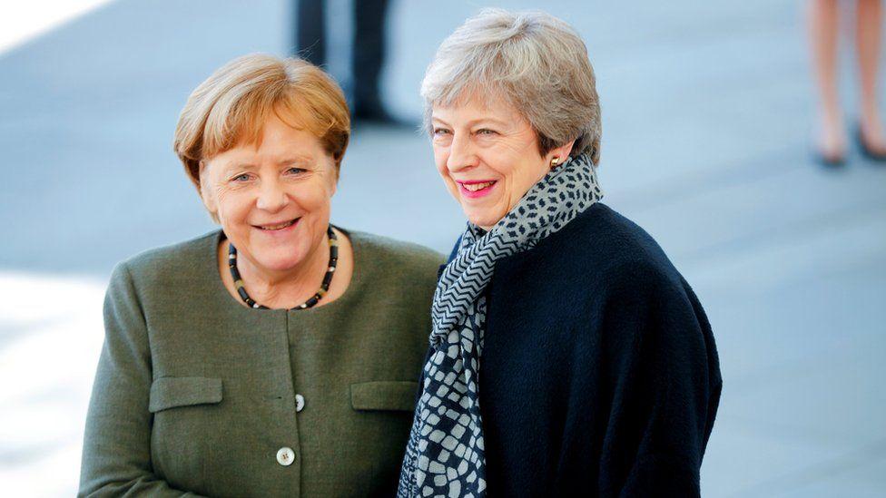 German Chancellor Angela Merkel greets Theresa May in Berlin