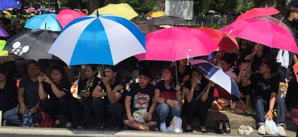 Mourners lining the streets of Bangkok awaiting the Thai King's funeral procession on 14 October 2016