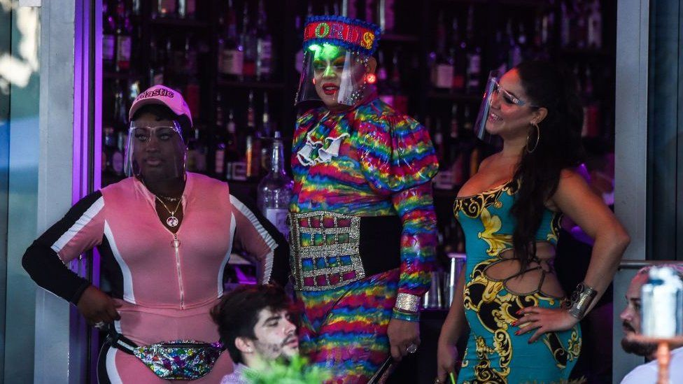 Professional drag performers wear face shields in Miami