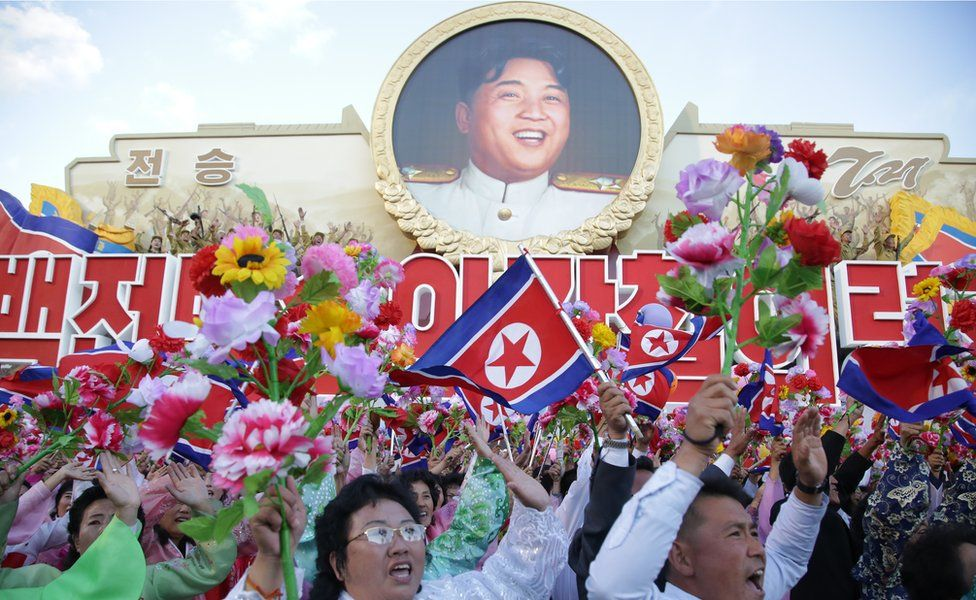 People cheering during the military parade for the 70th anniversary of the founding Workers' Party, Pyongyang, North Korea - Saturday 10 October 2015