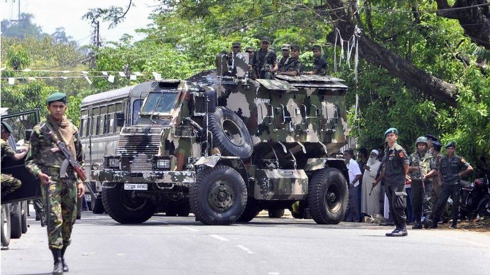 Sri Lankan police commandos patrol on the streets of Pallekele, a suburb of Kandy, on March 6, 2018, following anti-Muslim riots that has prompted the government to declare a state of emergency.