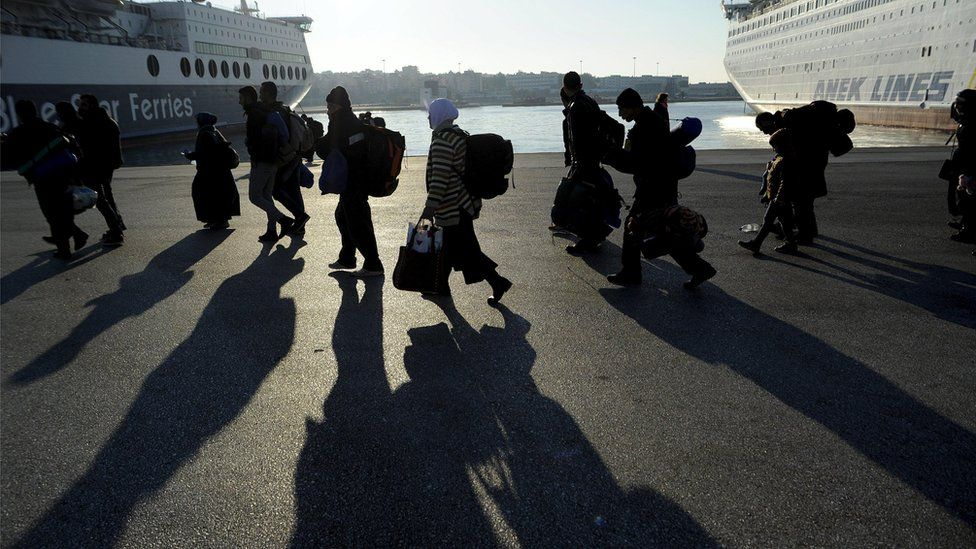 Migrants near a ferry in Piraeus, near Athens (26 December)
