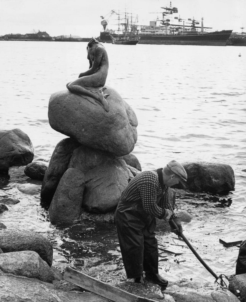A workman dredging the harbour in Copenhagen after the statue of the Little Mermaid was vandalised and beheaded