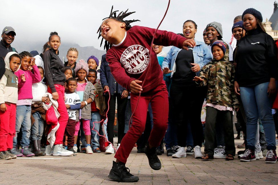 A child plays on a skipping rope during as people gather to commemorate what would have been Nelson Mandela's 99th birthday in Cape Town, South Africa, July 18, 2017.