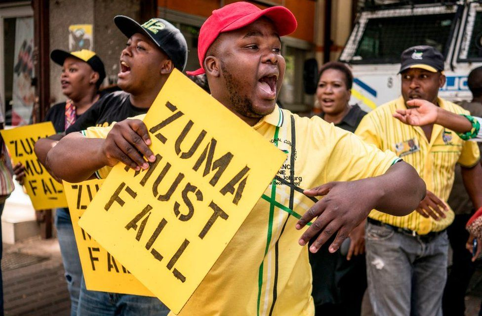 Supporters of the African National Congress Deputy President Cyril Ramaphosa hold placards and chant slogans outside the ANC party headquarter in Johannesburg, on February 5, 2018, during a demonstration to protest against South African President and ANC member Jacob Zuma. Senior members of South Africa's ANC party will hold an emergency meeting Monday to discuss whether President Jacob Zuma should stay in office after he reportedly refused to resign. Some African National Congress (ANC) members are pushing for Cyril Ramaphosa, the new head of the party, to replace Zuma as president immediately.