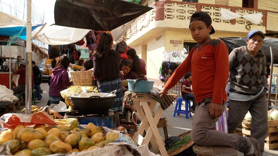 Boy at a stall in Comitancillo