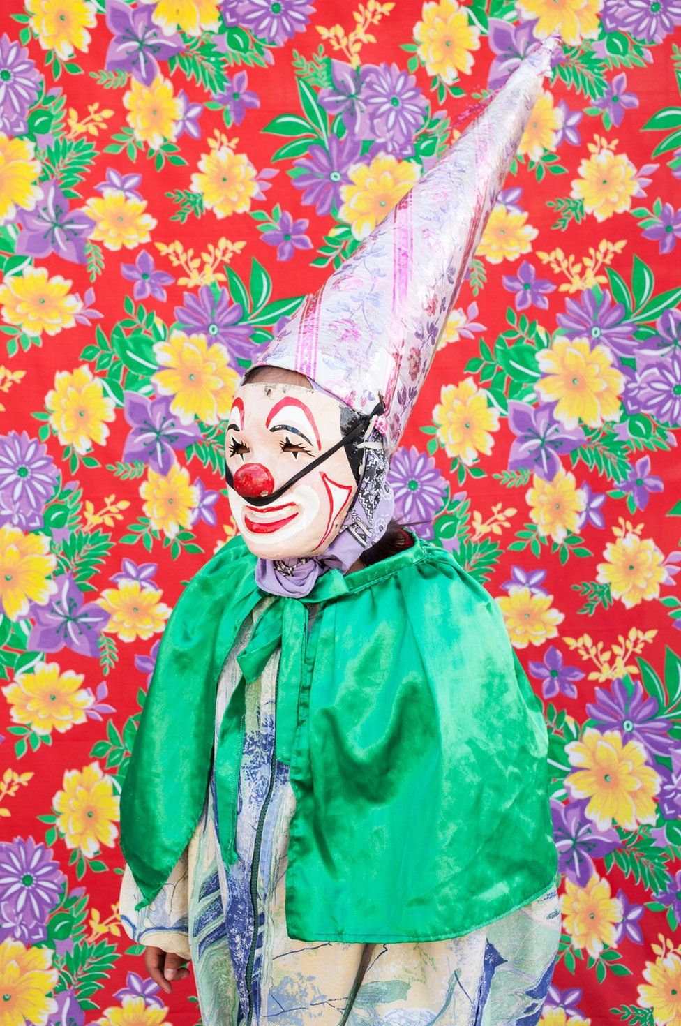 Portrait of clown in front of a patterned background