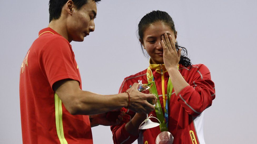 He Zi (R) reacts to the proposal