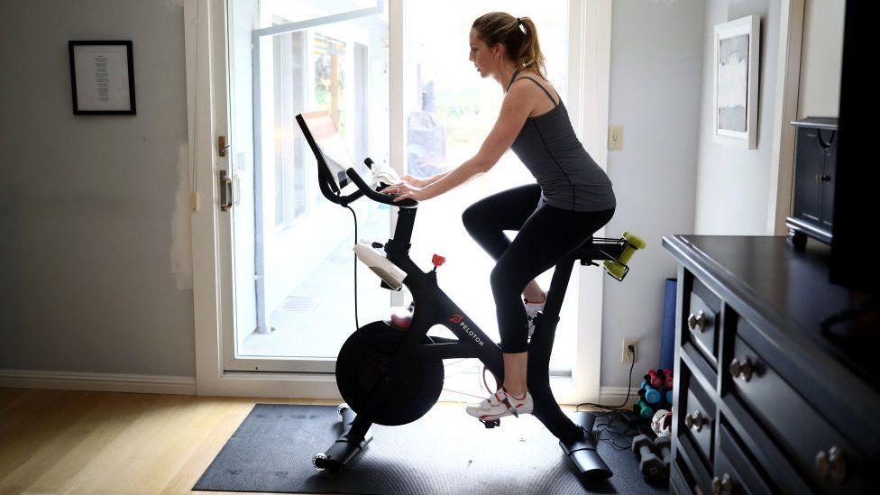 Person on a Peloton exercise bike