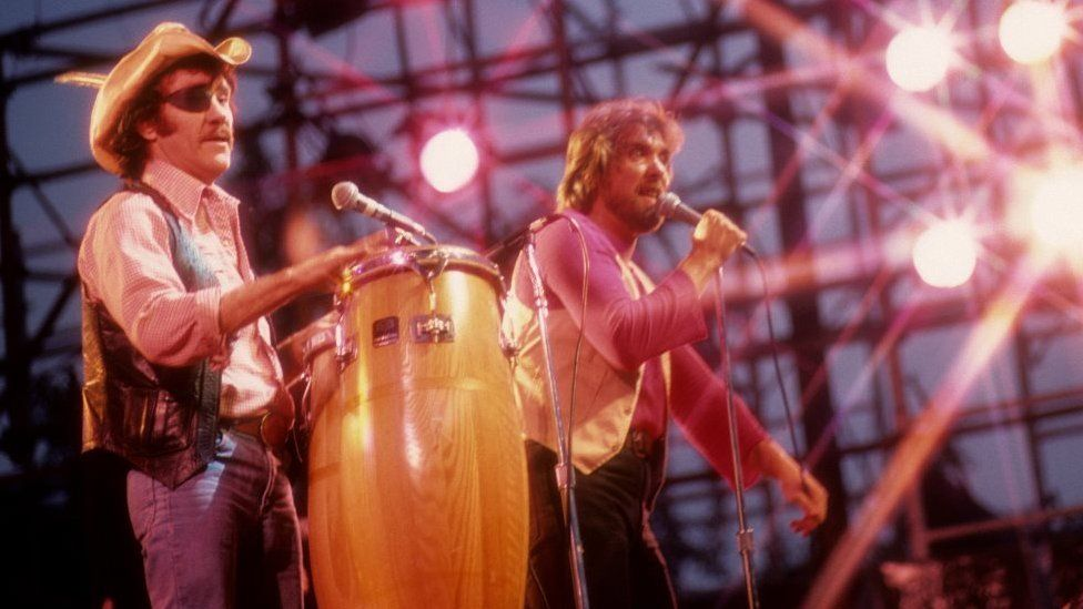 Singer Ray Sawyer and guitarist Dennis Locorriere American rock band Dr. Hook performing at the Schaefer Music Festival at the Wollman Rink in Central Park on August 22, 1979 in New York City