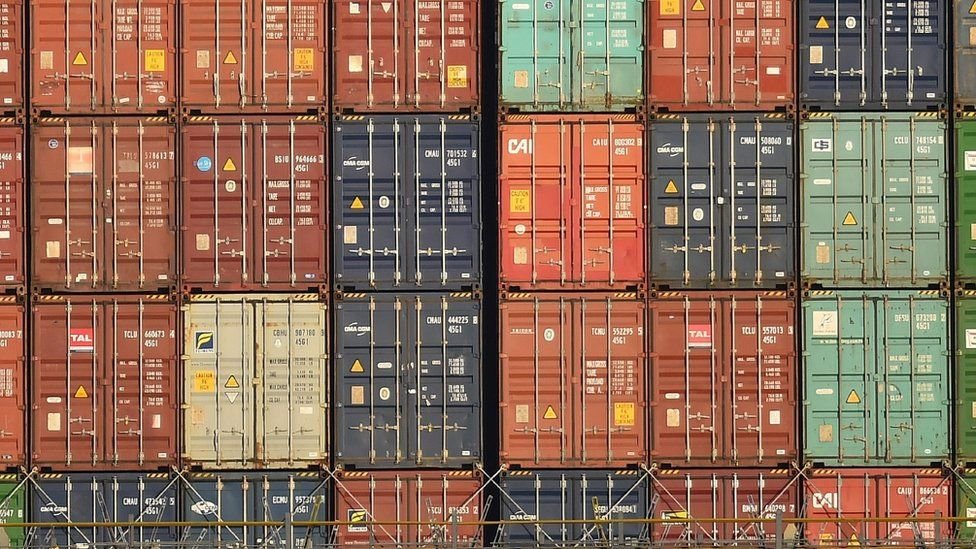 shipping containers piled up